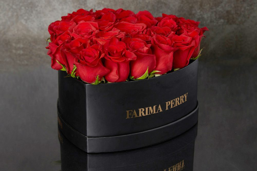 Red Roses in signature Black Heart Flower Box
