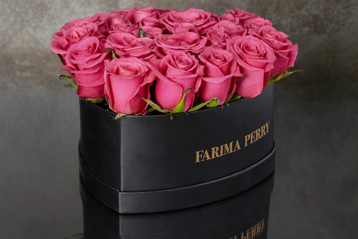 Raspberry Roses in signature Black Heart Flower Box